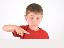 Boy Pointing to Blank Object on White Background Stock Image