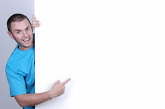 Boy pointing to a blank space ready for copy Royalty Free Stock Photography