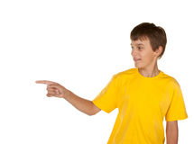 Boy pointing to copyspace. Young boy pointing to white copyspace Stock Photos