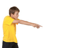 Boy pointing to copyspace. Isolated on white Royalty Free Stock Photo
