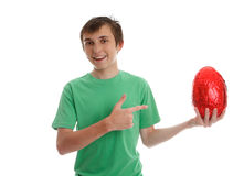 Boy pointing to an easter egg Royalty Free Stock Images
