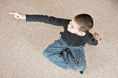 Boy pointing top view Royalty Free Stock Image