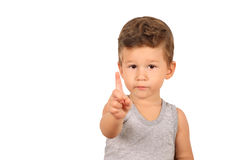 Boy pointing up with finger. Portrait of little boy pointing up with finger isolated on white background Stock Photo