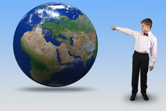 Boy points a finger at the globe Royalty Free Stock Image