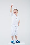 Boy points a finger somewhere Royalty Free Stock Image