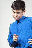 Boy points his finger. At the background Stock Photo