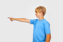 Boy points his finger at something or somebody Royalty Free Stock Image