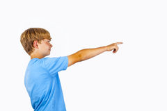 Boy points his finger at something or somebody Royalty Free Stock Photos