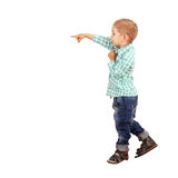 The boy points his finger towards Stock Image