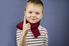 Boy points his finger. Up on a blue background Royalty Free Stock Images