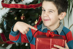Boy points out his gift on Christmas Royalty Free Stock Photography