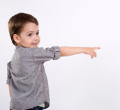 Boy points at something Stock Photo