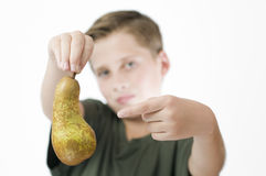 Boy points to a pear Stock Photo