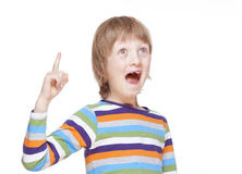 Boy Points up his Finger, Has an Idea Royalty Free Stock Image