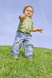 Boy poking at you. A child pointing at camera, against blue sky Royalty Free Stock Photo