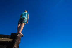 Boy Pole Standing Balancing Sky Stock Images