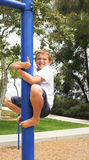 Boy on pole with thumbs up sign Royalty Free Stock Photos