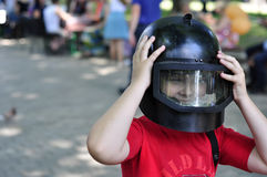 Boy in a police helmet Royalty Free Stock Photography
