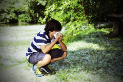 Boy with pollen allergy with white handkerchief Stock Photos