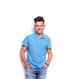 Boy in polo shirt posing with hands in pockets Stock Image