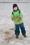 Boy on pond Stock Image