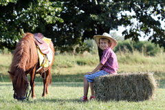 Boy and pony horse on farm Stock Images