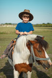 Boy with pony. Little boy in cowboy hat on pony Royalty Free Stock Photography