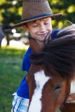 Boy and pony Stock Image