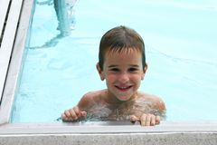 Boy in the pool. Boy swimming in the pool Stock Photo