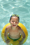 Boy in a pool Stock Photography