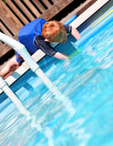 Boy by pool Royalty Free Stock Images