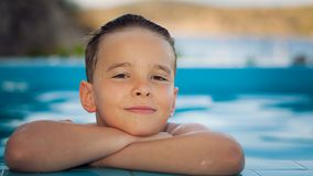 Boy at the pool Stock Photos