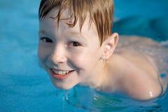 Boy in pool Stock Photos