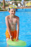 Boy in pool Stock Photos