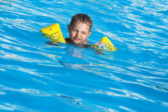 The boy in pool Stock Image
