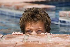 Boy in a Pool Stock Image