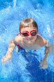 Boy in the pool with goggles Stock Photography