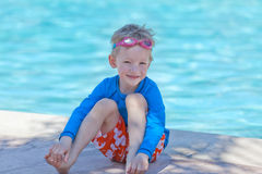 Boy by the pool Royalty Free Stock Photo