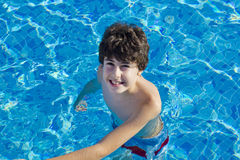 The boy is in the pool Royalty Free Stock Photography