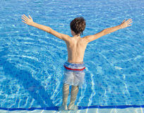 The boy  in the pool Stock Image