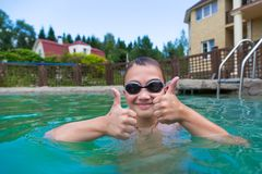 Boy in the pool outdoors Royalty Free Stock Images