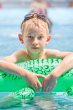 Boy in the pool Stock Photography