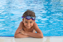 Boy in the pool Royalty Free Stock Images