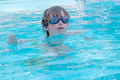 Boy in the pool Stock Images