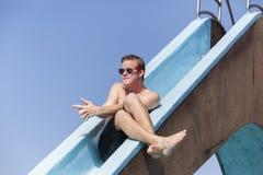 Boy Pool Slide Fun Stock Photos