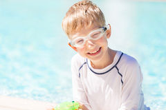 Boy by the pool Royalty Free Stock Images