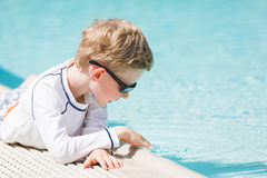 Boy by the pool Stock Images