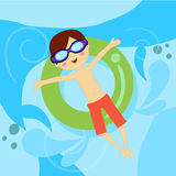 Boy in pool with tube Stock Photo