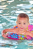 Boy In Pool 2. A young child with a float ring, in a pool stock photos