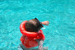 Boy in the pool Stock Photos